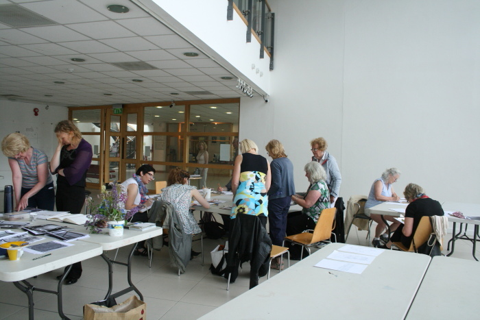 Workshop participants working in gallery